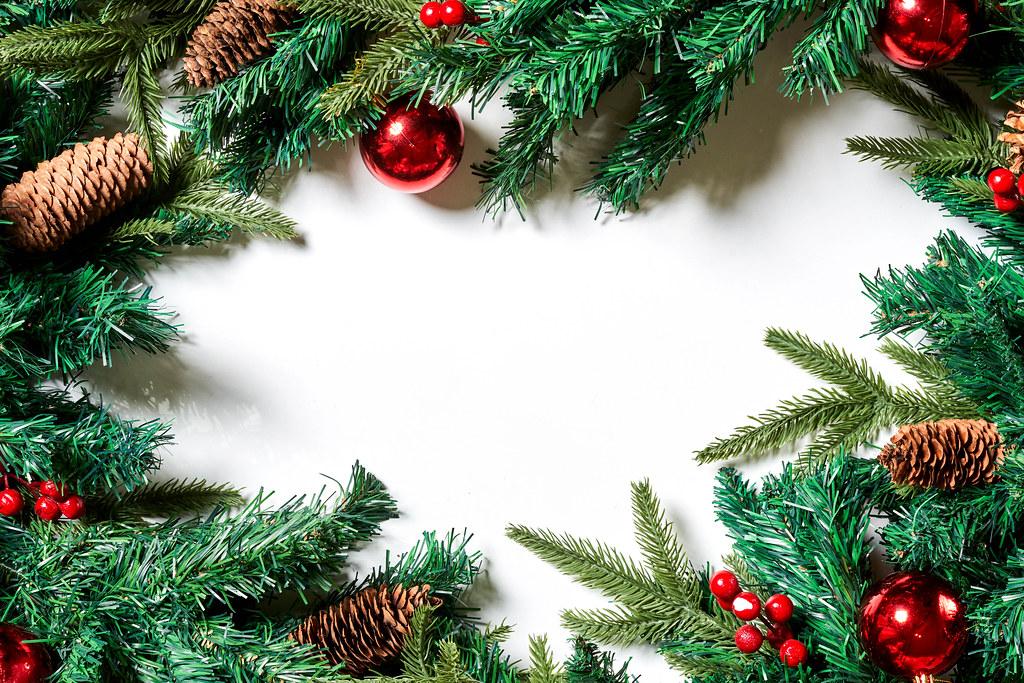 Decorative evergreen branches festive frame on white background