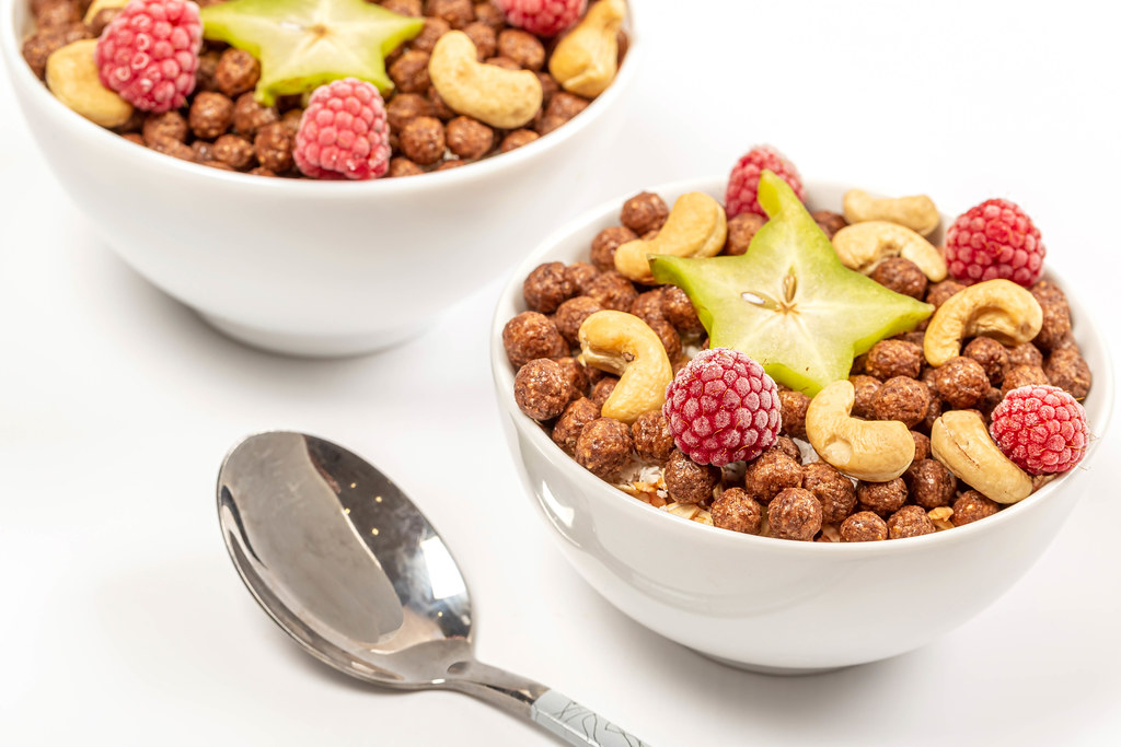 Delicious breakfast background with starfruit, almonds and raspberries