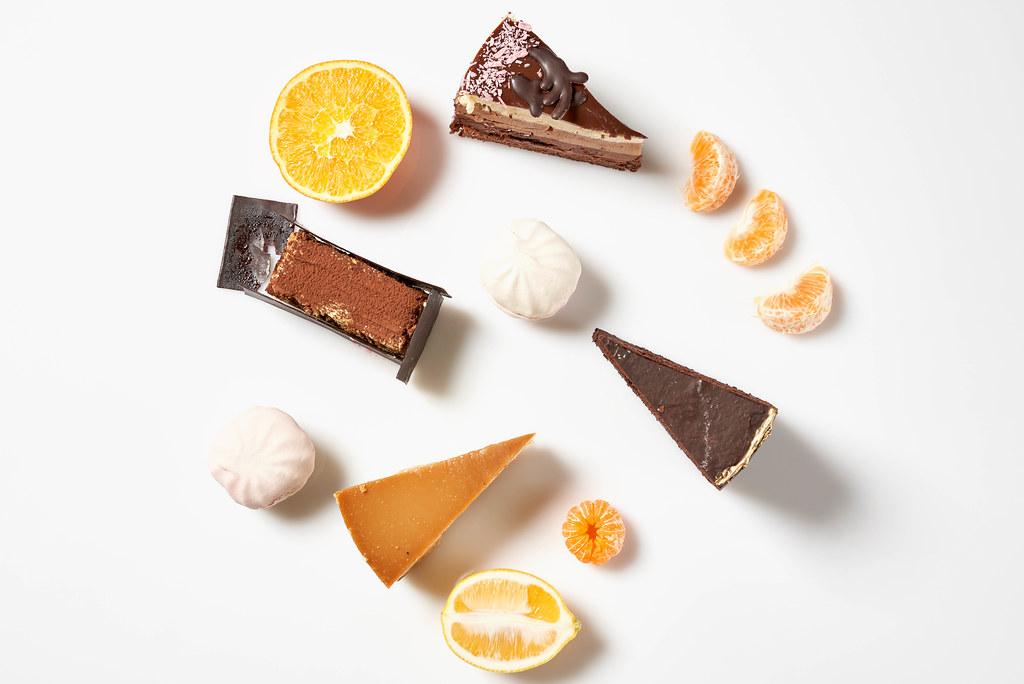Delicious cakes with lemon, orange and mandarin fruit slices