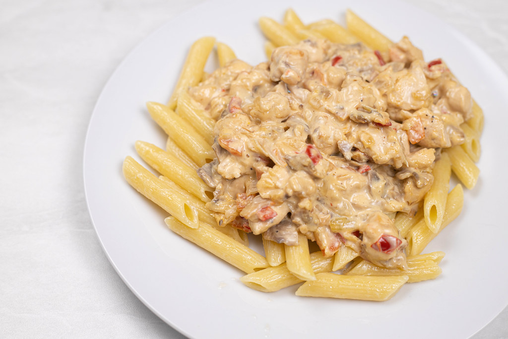 Delicious Chicken with Mushrooms and Macaroni served on the plate