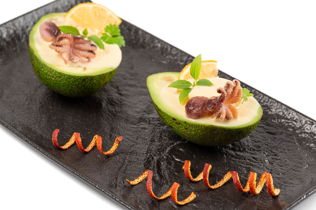 Delicious dish with avocado, octopus and creamy sauce
