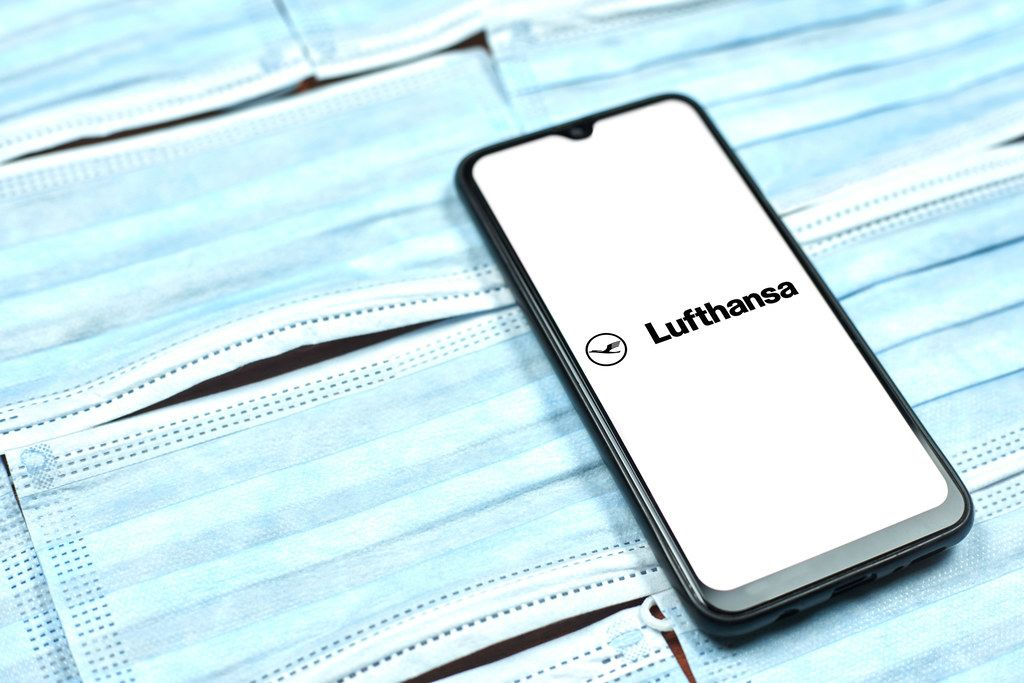 Deutsche Lufthansa AG logo on phone display. Covid-19 effect on company business