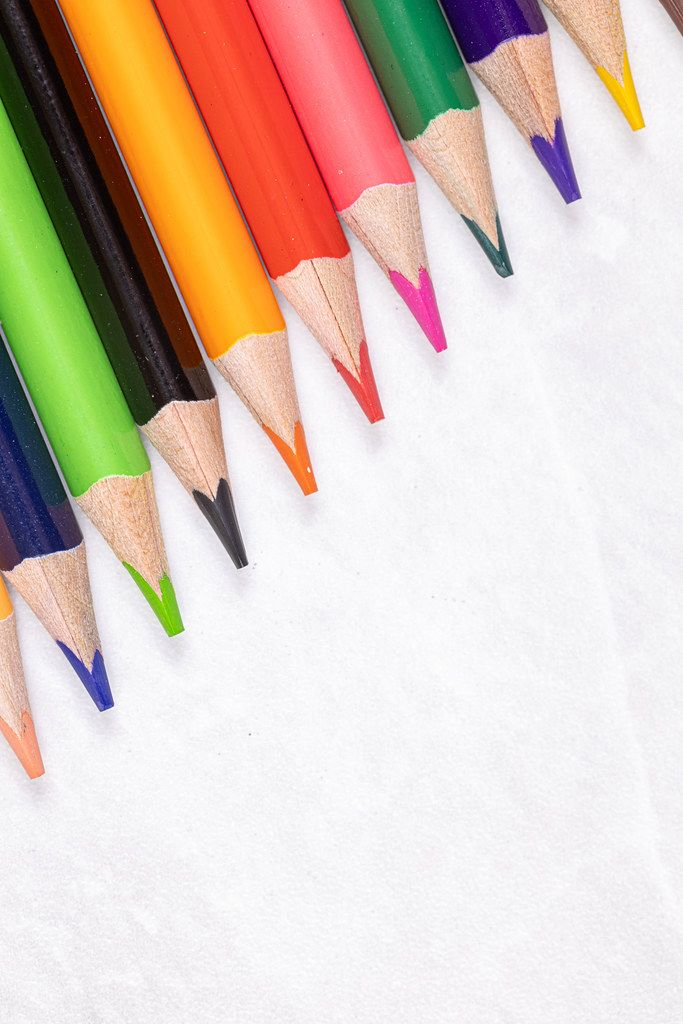 Diagonal Colorful Wooden Pencils with copy space above white background