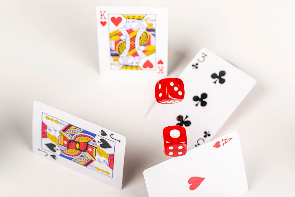 Dice and cards are flying, poker game concept