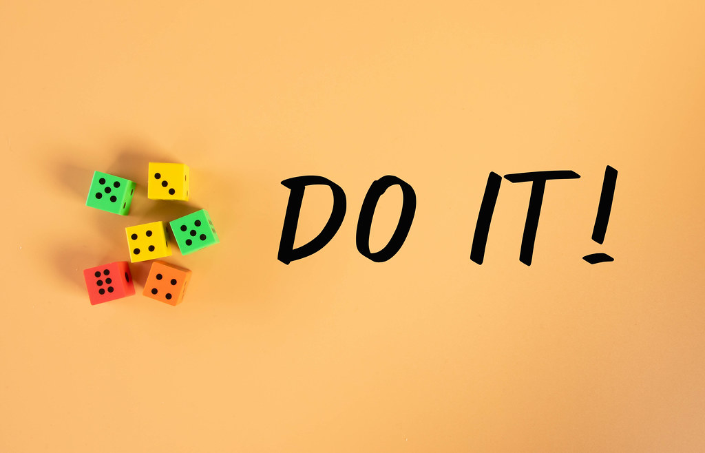 Dices with Do it! text on orange background