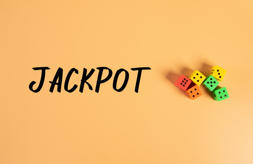 Dices with Jackpot text on orange background
