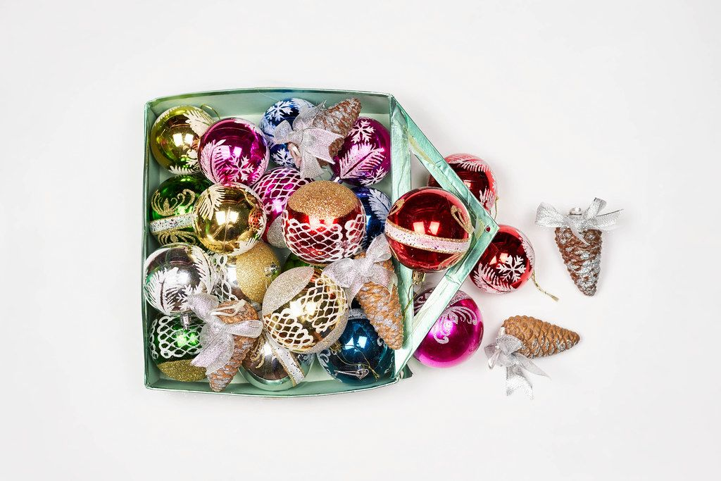 Different christmas ornaments in a box, on a white background