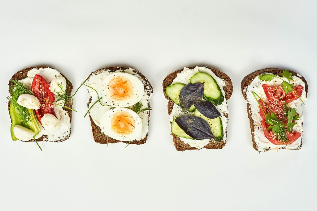 Different dieting toast snacks on white background