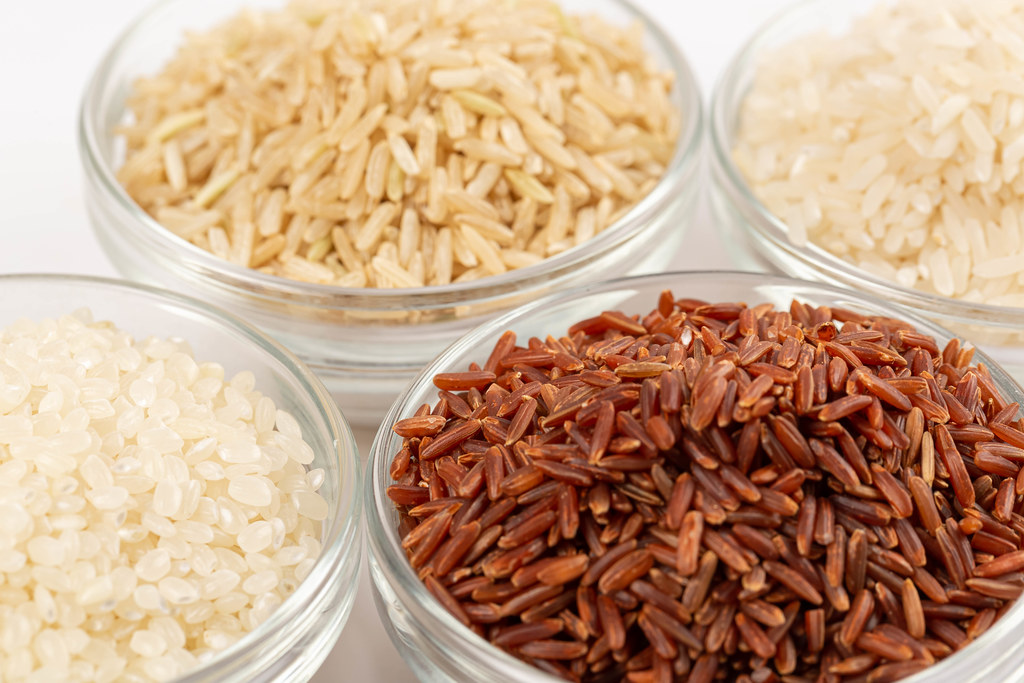 Different varieties of rice in glass bowls