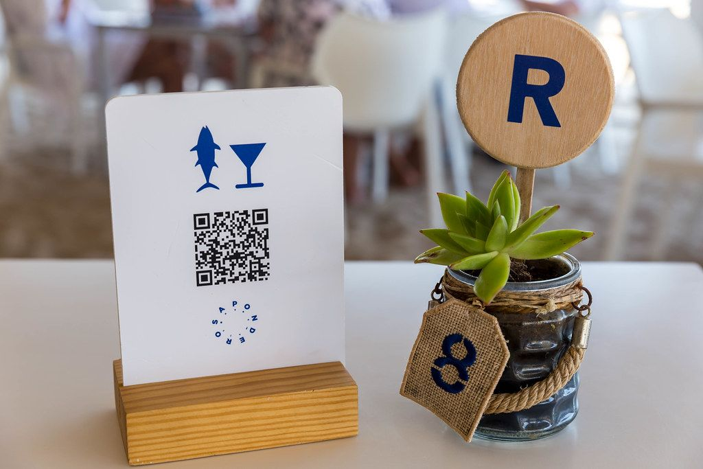 Digital menu for smartphones with QR-code at Mallorca restaurant during the coronavirus pandemic