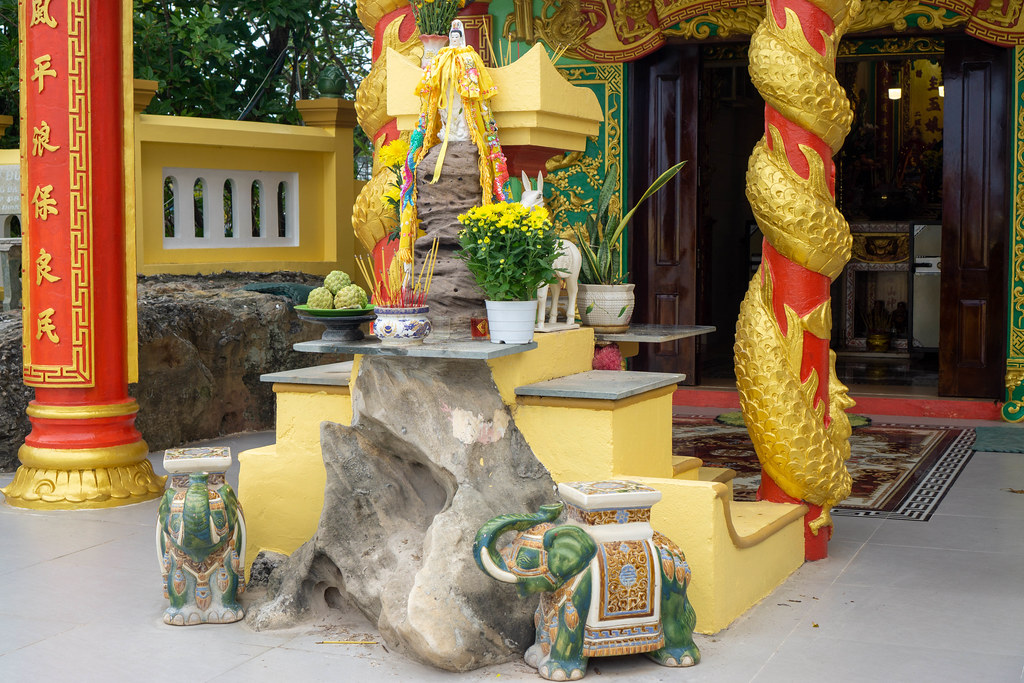 Dinh Cau Shrine with Elephant Statues, Lady Buddha, Incense Sticks and Offerrings on Phu Quoc Island, Vietnam