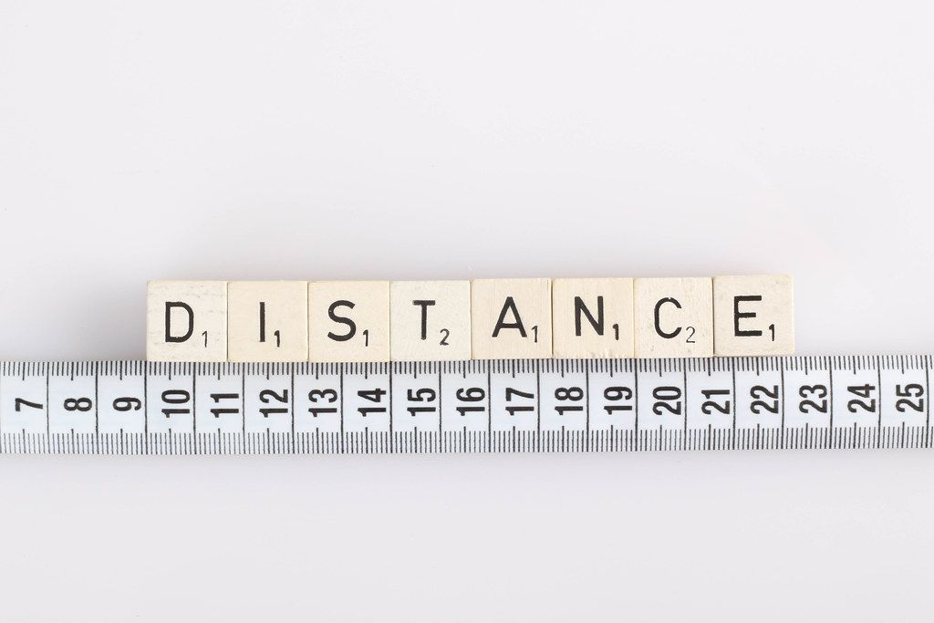 Distance text on wooden blocks with white tape measure
