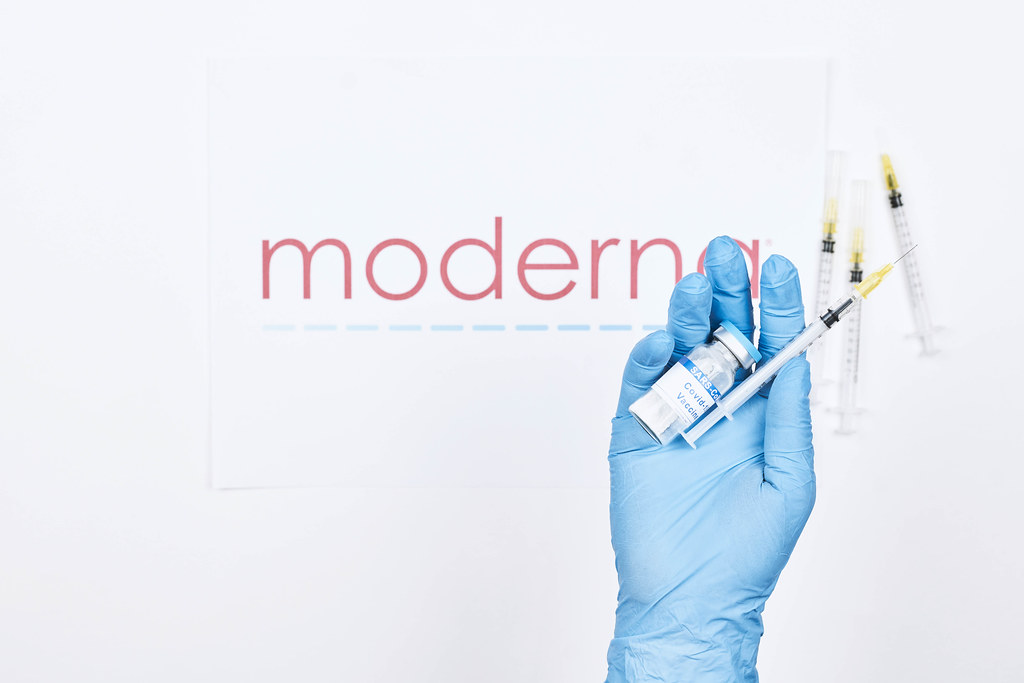 Doctor holds an injection with new Moderna vaccine