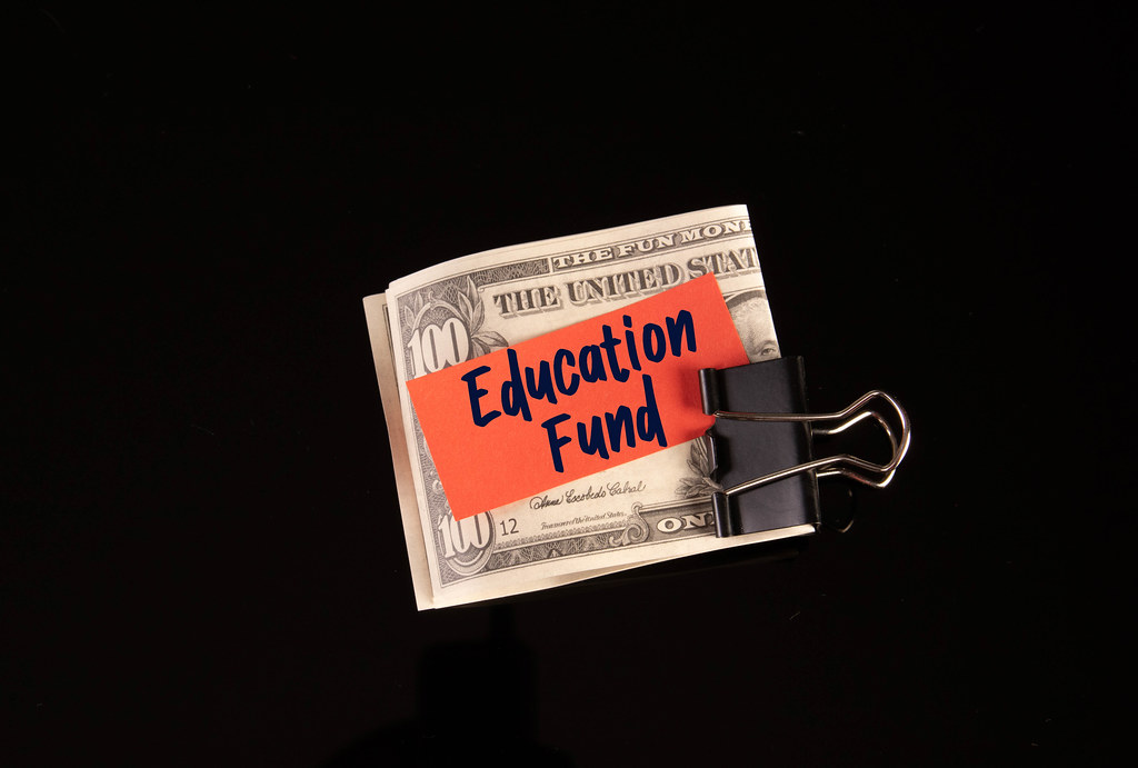 Dollars in money clip with Education Fund text