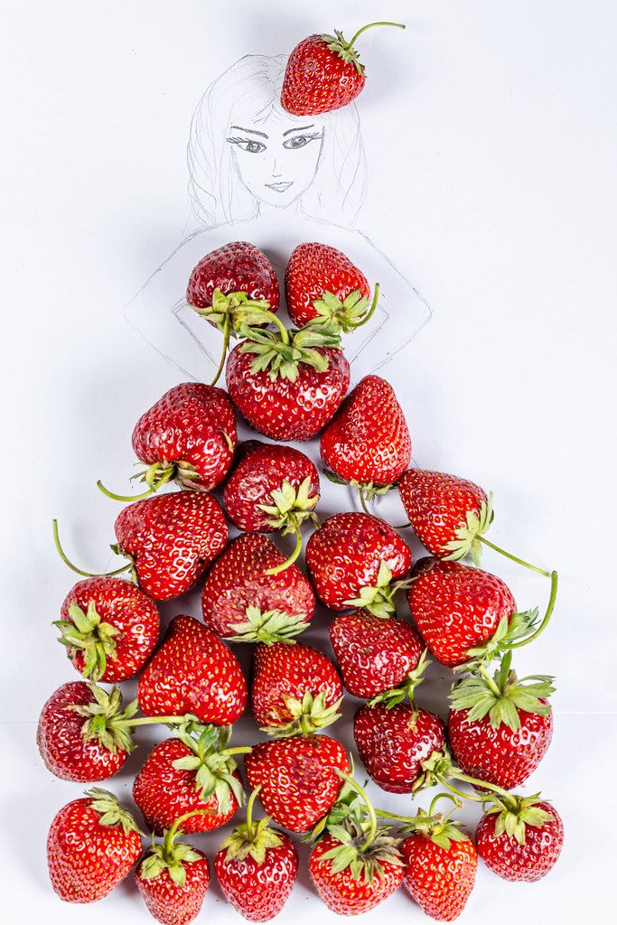 Drawing of a girl in a dress made of natural fresh strawberries