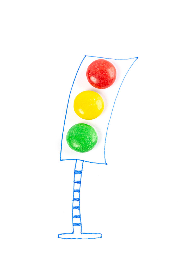 Drawn traffic light with colored candies instead of lamps