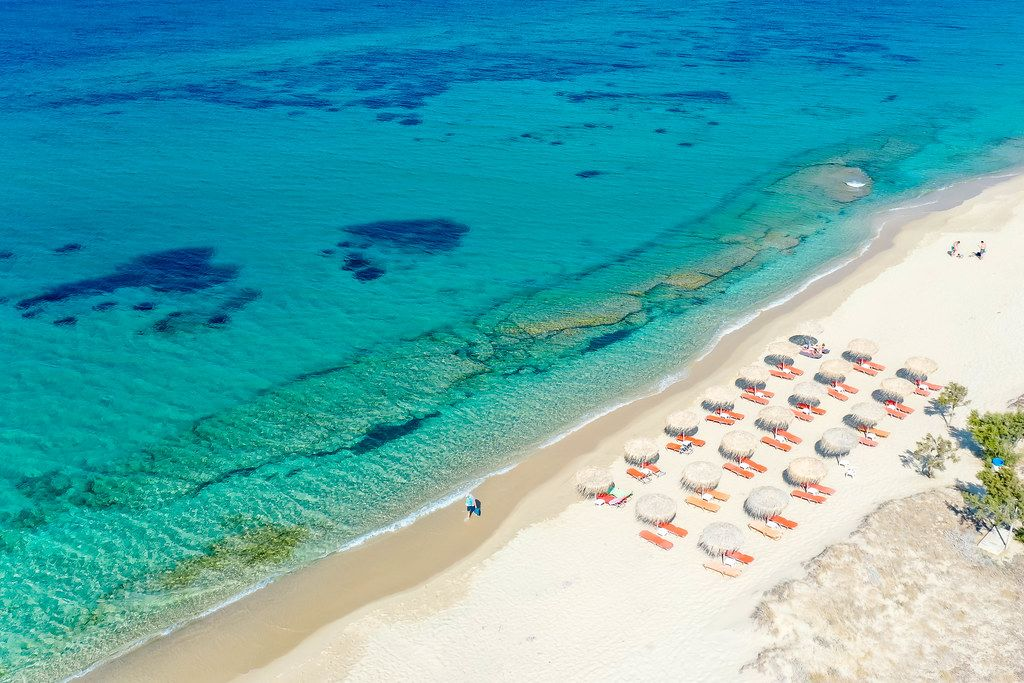 Dream holiday destination: the sandy beach of Plaka on the island of Naxos with blue sea and no crowds