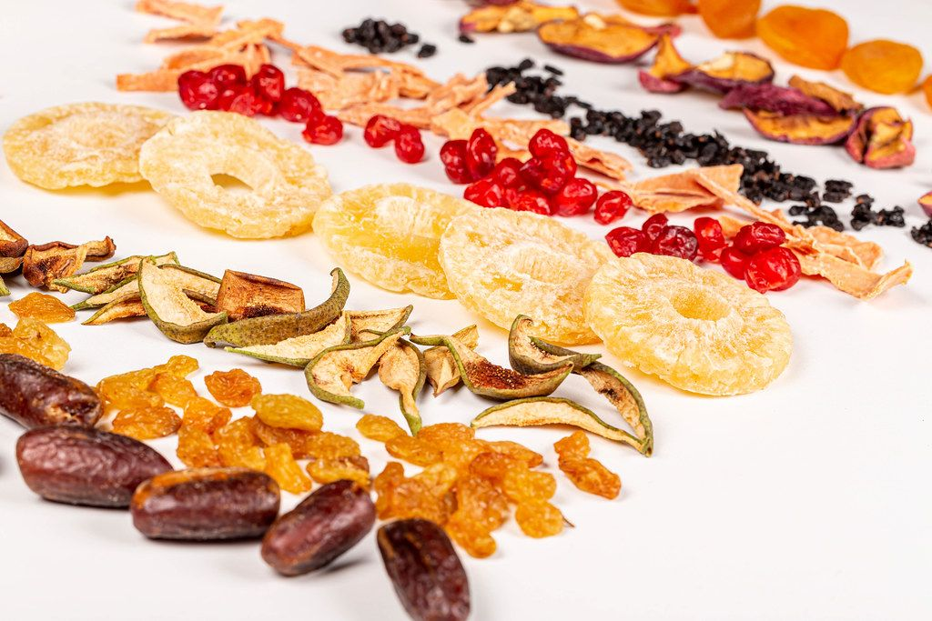 Dried fruits assortment on white background, healthy food concept