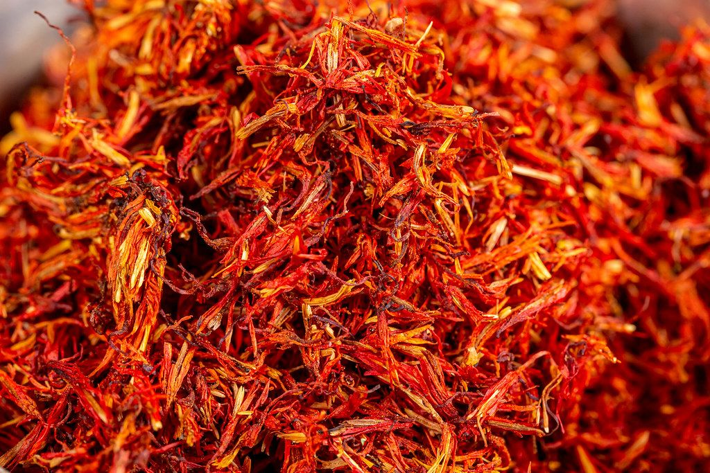 Dried red saffron spice background
