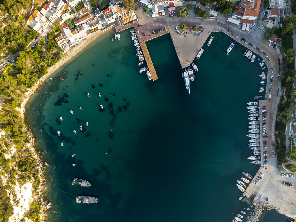 Drone image of the harbour and bay of Patitiri with docked boats on Alonnisos, Northern Sporades