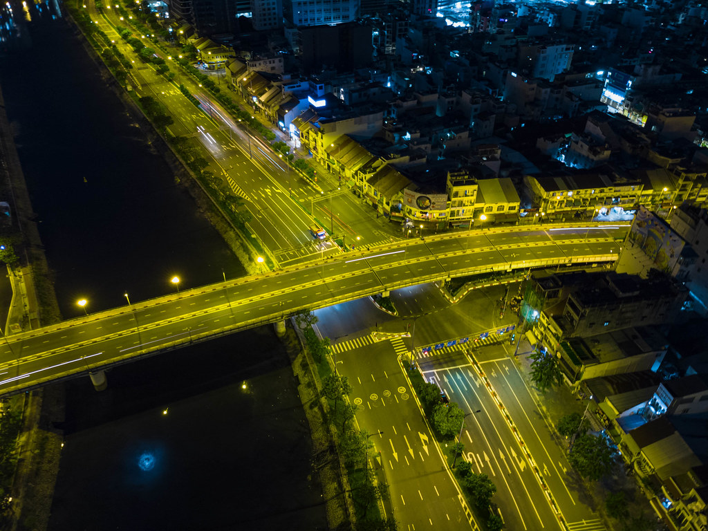 Drone Night Photo of Ong Lanh Bridge over Saigon River with less traffic due to a Lockdown in Ho Chi Minh City, Vietnam