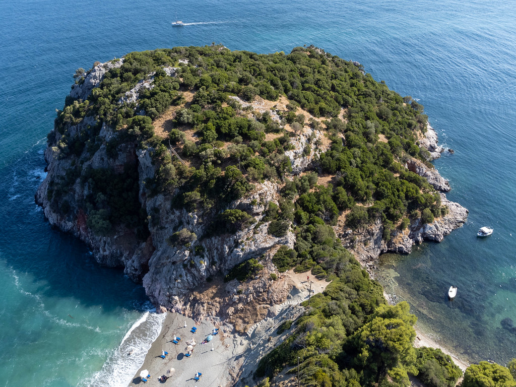 Drone photo of the headland and archaeological site separating Velanio and Stafylos beaches on Skopelos