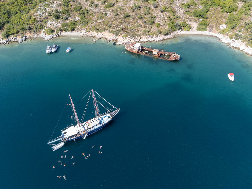 Drone photography: holidaymakers on a sail boat tour to the shipwreck of Peristera with its underwater treasures