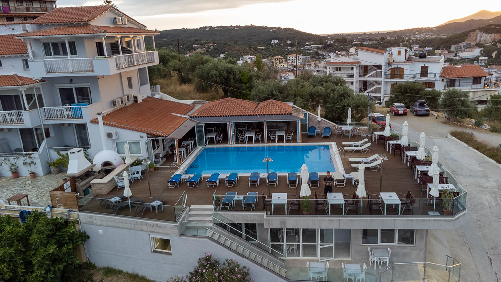 Drone photography while standing by the hotel pool on holiday in Greece