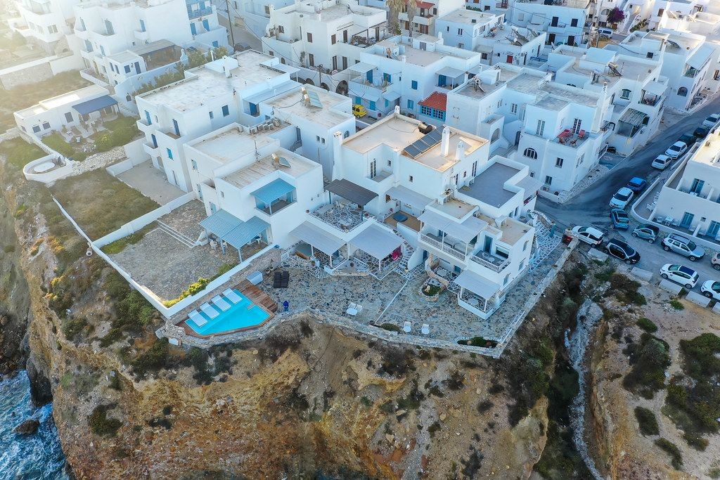 Drone shot from the Iliada Sunset Suites complex in Naxos. Hotel with a pool on the edge of the cliff