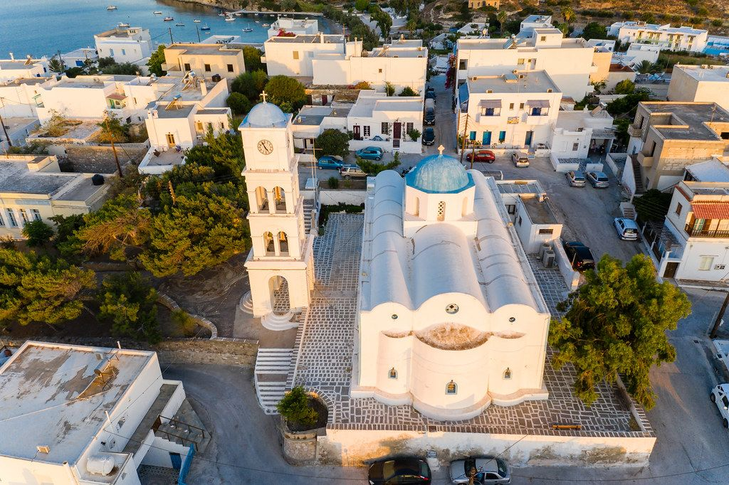 Drone shot of an icon of Milos: the church of Agios Charalambos with the typical Greek blue dome