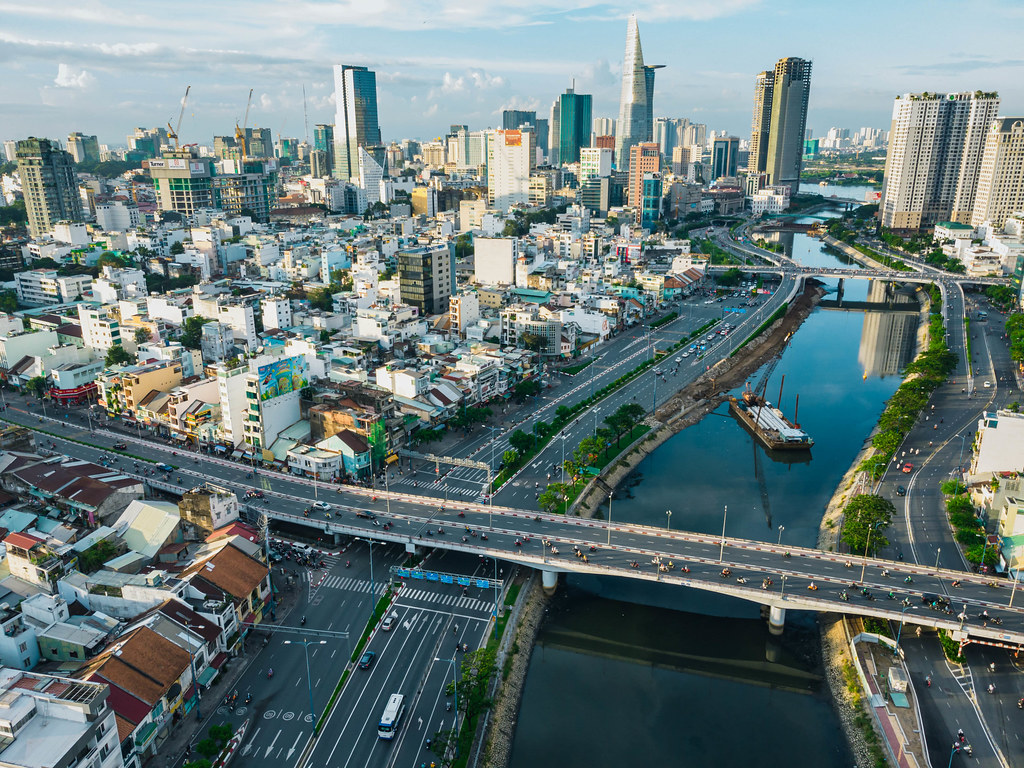 Drone Shot of Traffic on Bridges over Saigon River with the City Skyline in the Background in Ho Chi Minh City, Vietnam