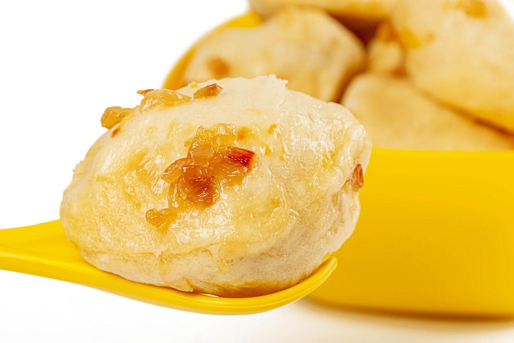 Dumpling in a spoon, close-up