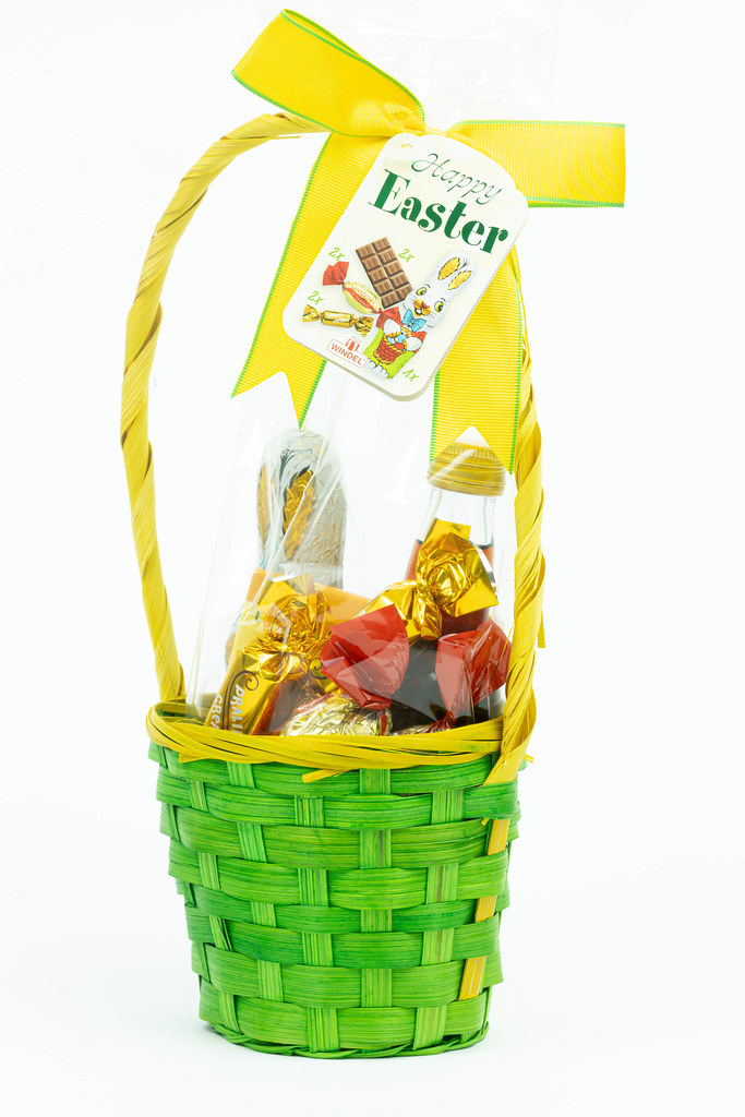 Easter eggs and chocolate in the woven basket