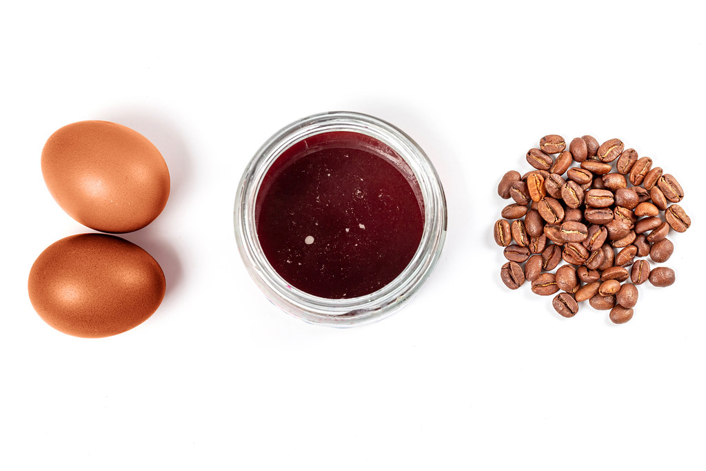 Easter eggs dyeing with coffee, top view