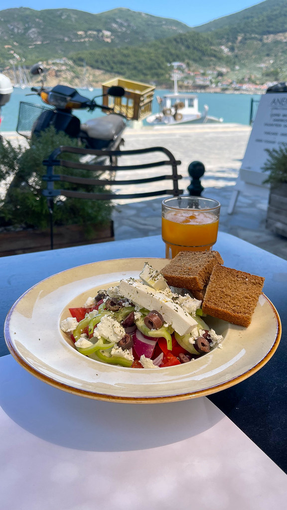 Eating vegetarian while on holiday on Skopelos, Greece: plate with feta, tomatoes, green peppers, onions (Greek Salad)