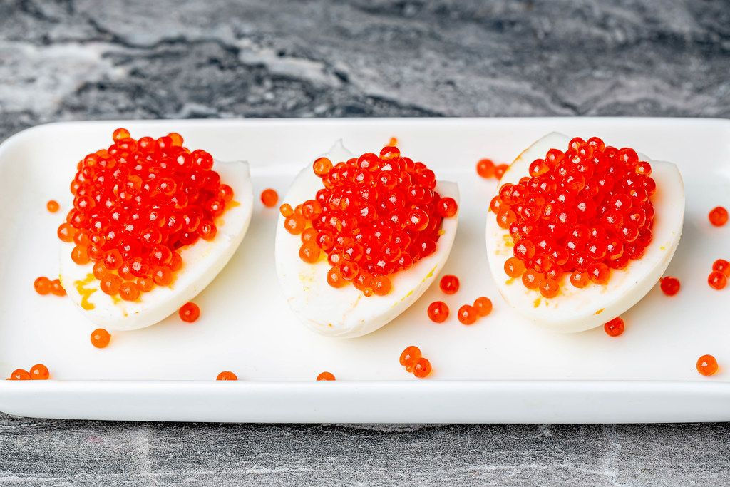 Egg and red caviar appetizer