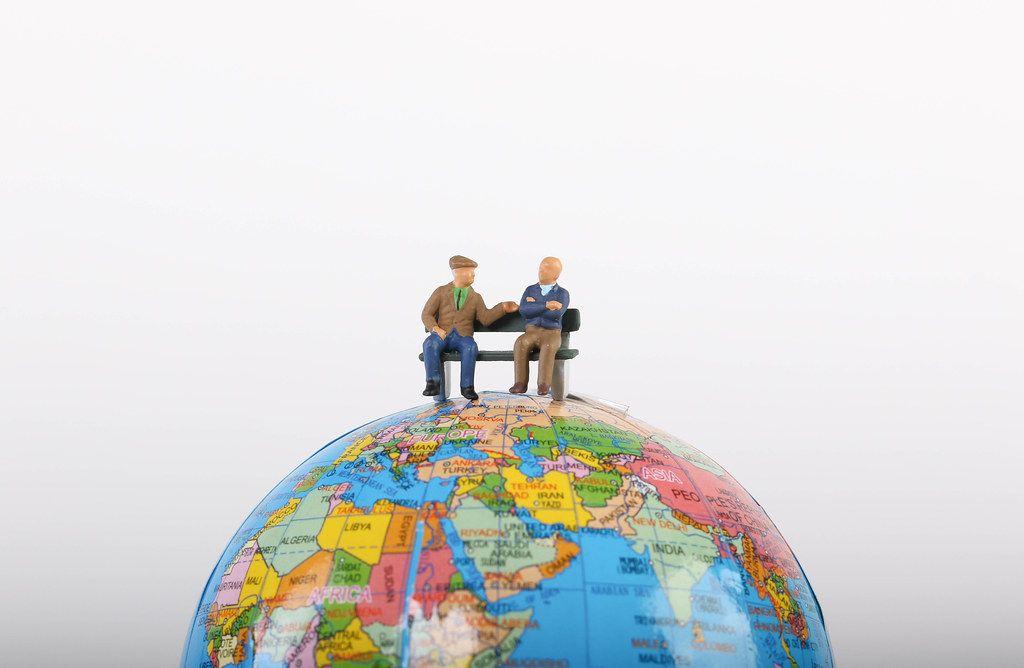 Elderly people sitting on globe