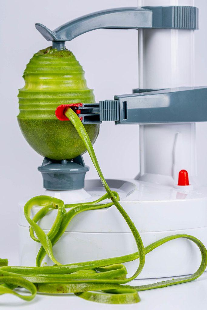 Electric fruit and vegetable peeling machine peels avocado