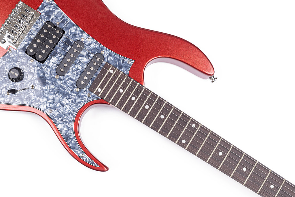 Electric Guitar above white background