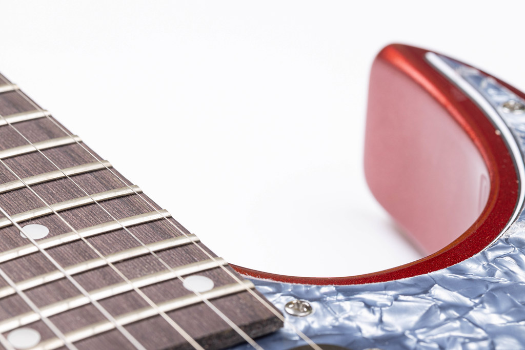 Electric Guitar and music concept with white background copy space