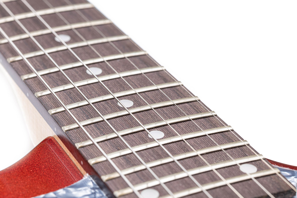 Electric Guitar Frets on the neck closeup