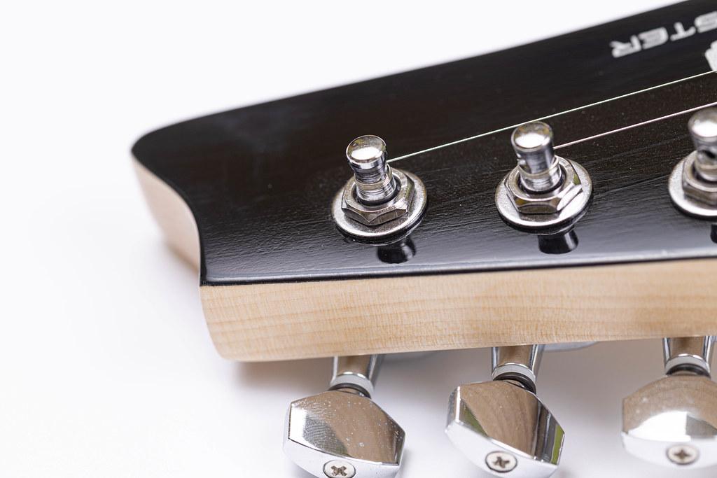 Electric Guitar Head closeup above white background