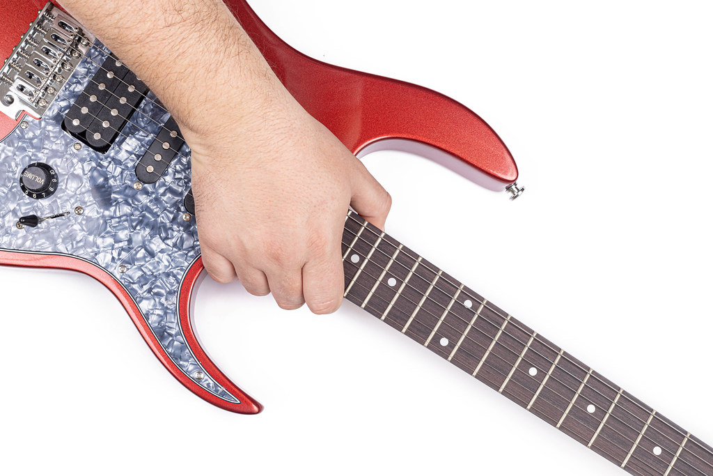 Electric Guitar in the hand above white background