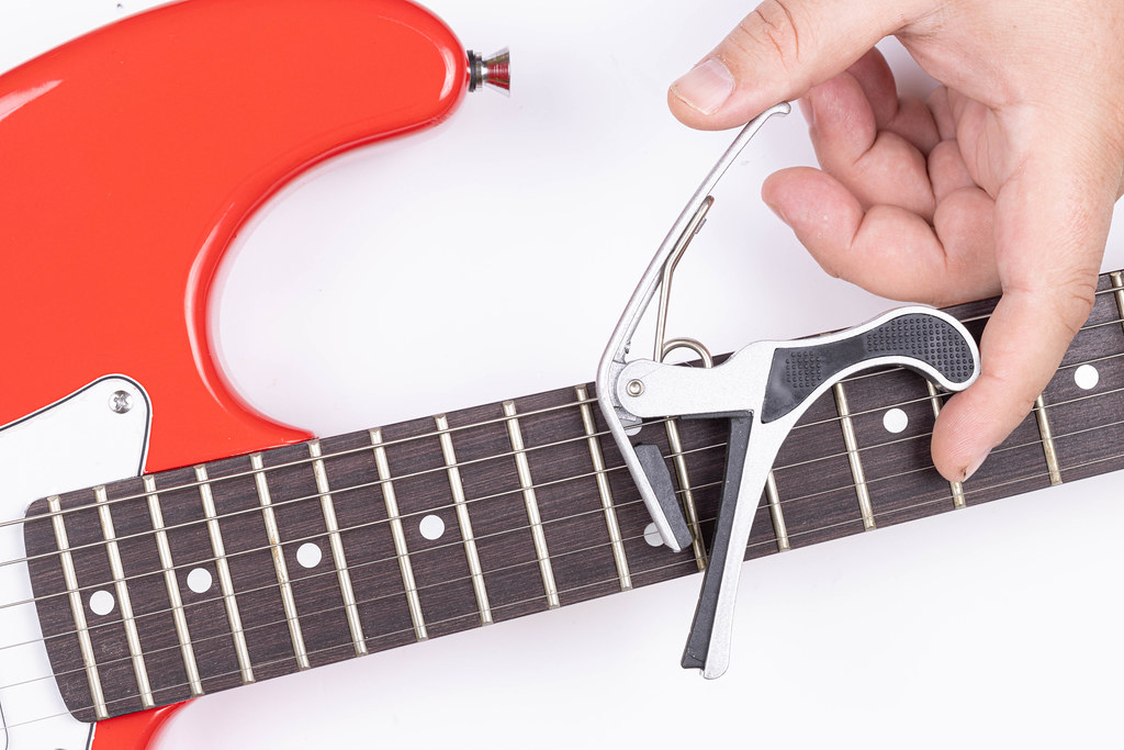 Electric Guitar with Capodastro in the hand