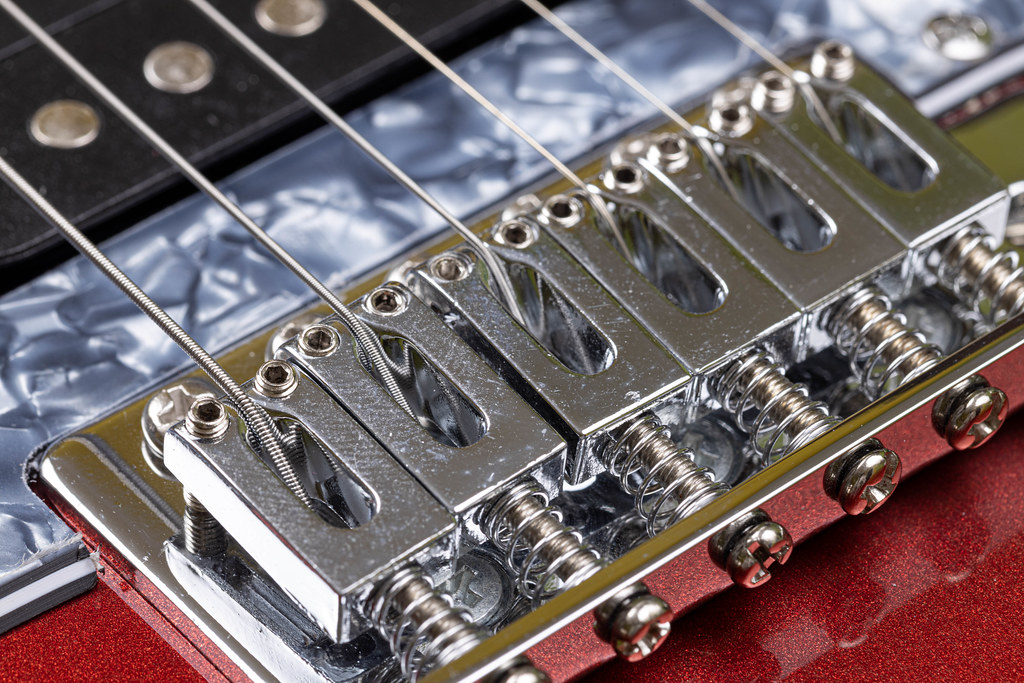 Electric Guitar's Bridge with Strings on it