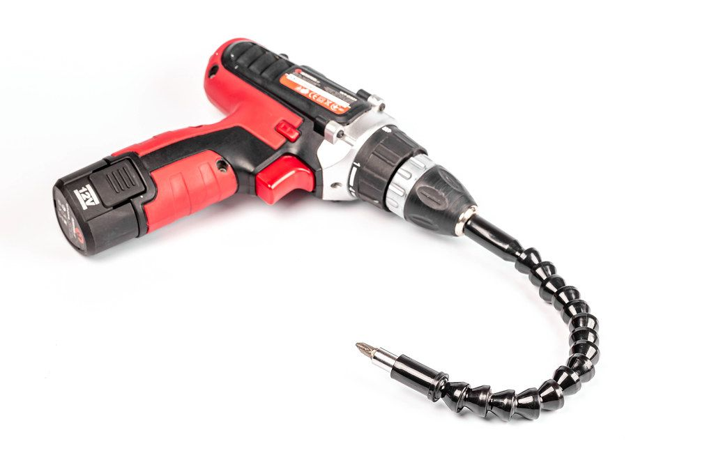 Electric screwdriver with a flexible extension on white background