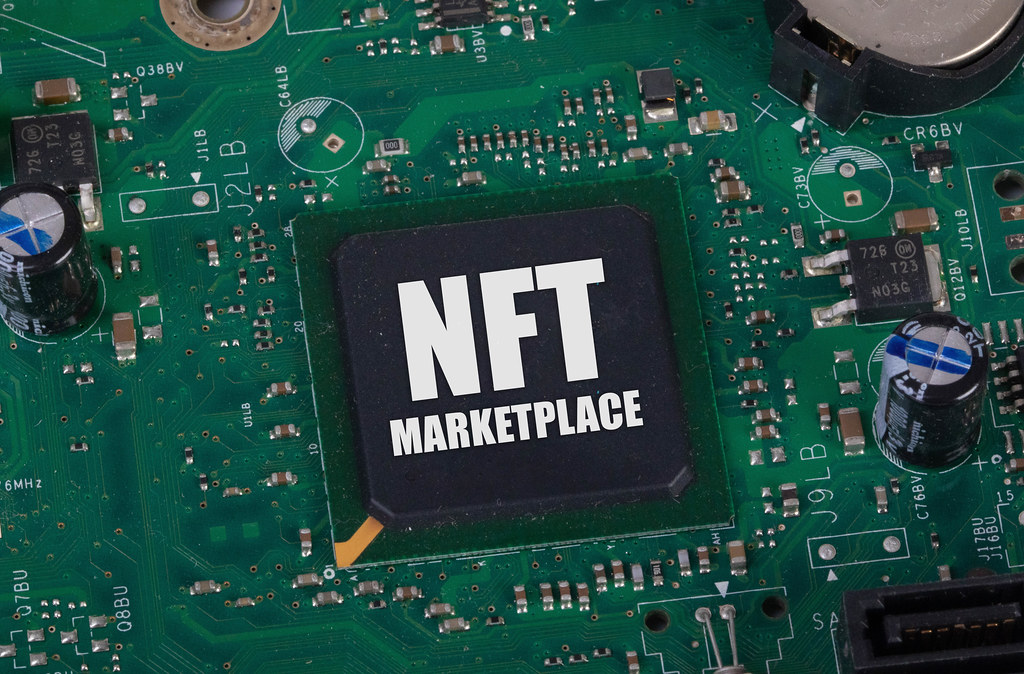 Electronic circuit board with NFT Marketplace text