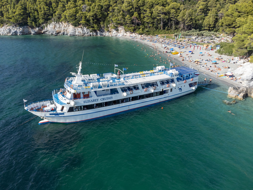 Elisabet cruise ship in front of Kastani beach: the most famous beach on Skopelos. Drone image