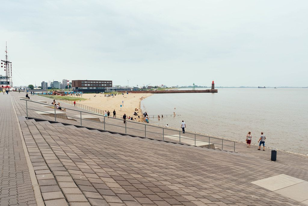 Embarkment and the beach with the lighthouse in German sea town of Bremerhaven
