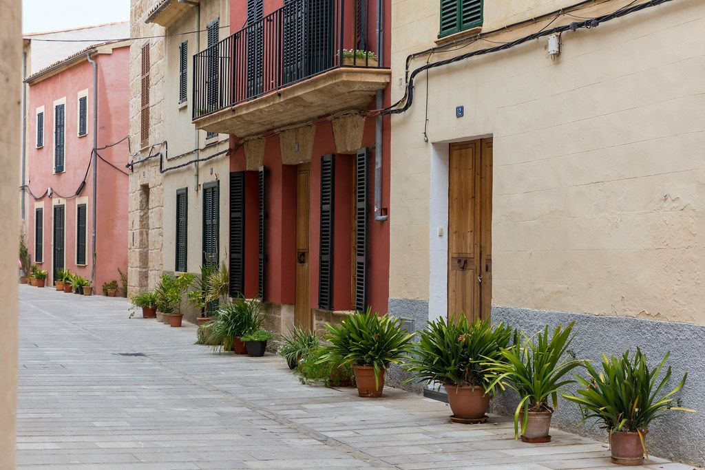 Empty alley with plants in front of houses in the beautiful town of Alcudia in the north of Majorca